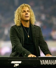 """Bon Jovi keyboardist David Bryanannounced March 21 that hetested positive for the coronavirus.  """"I've been sick for a week and feeling better each day,"""" Bryan wrote in an Instagram post. """"Please don't be afraid!!! It's the flu not the plague. I've have been quarantined for a week and will for another week. And when I feel better I'll get tested again to make sure I'm free of this nasty virus. Please help out each other. This will be over soon ... with the help of every American!!"""""""