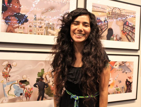 Mexican children's book author-illustrator Yuyi Morales said the lights strung below the ceiling of the National Center for Children's Illustrated Literature, reflected in the glass covering her artwork, added dazzle to her exhibition. She saw the retrospective display Monday for the first time.