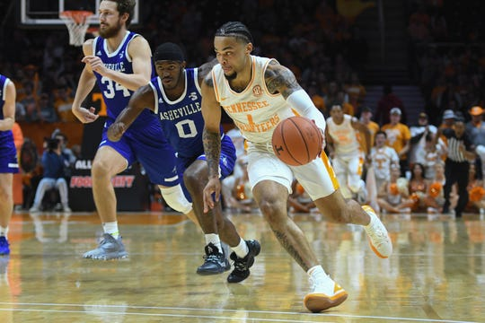 Nov 5, 2019; Knoxville, TN, USA; Tennessee Volunteers guard Lamonte Turner (1) controls the ball against North Carolina-Asheville Bulldogs guard Lavar Batts Jr. (0) during the first half at Thompson-Boling Arena. Mandatory Credit: Randy Sartin-USA TODAY Sports