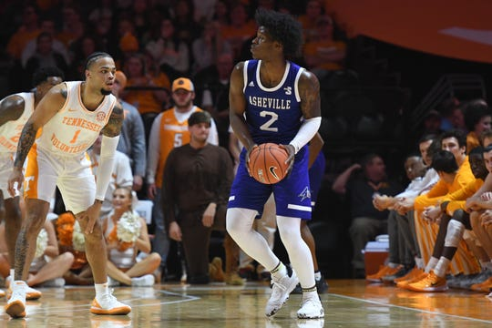 Nov 5, 2019; Knoxville, TN, USA; North Carolina-Asheville Bulldogs guard LJ Thorpe (2) looks to pass the ball against Tennessee Volunteers guard Lamonte Turner (1) during the first half at Thompson-Boling Arena. Mandatory Credit: Randy Sartin-USA TODAY Sports