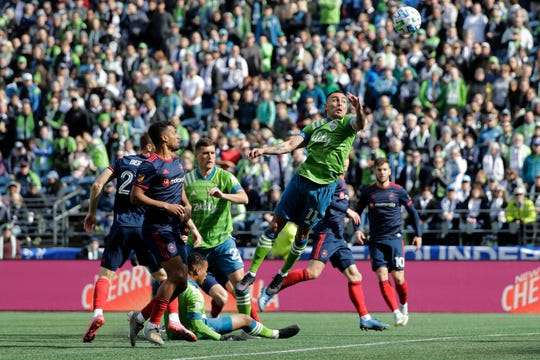 Seattle Sounders defender Miguel Ibarra (11) leaps to head the ball against the Chicago Fire during the first half of an MLS soccer match, Sunday, March 1, 2020, in Seattle. (AP Photo/Ted S. Warren)