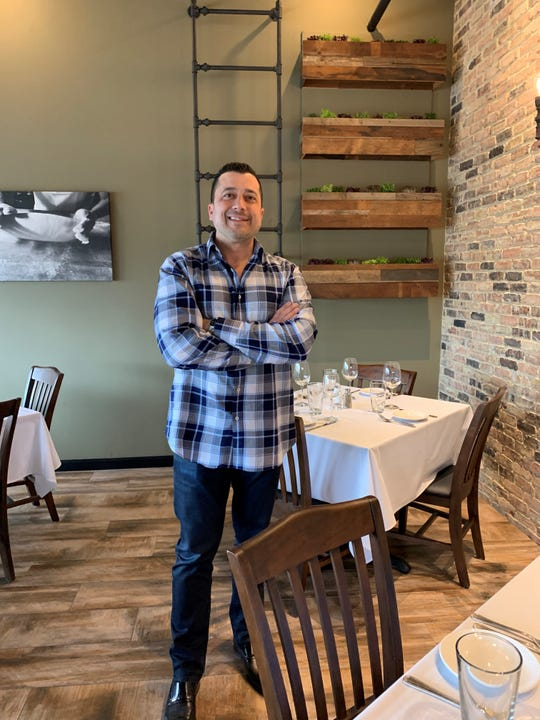 Chef/owner Jim Marino stands in the dining room of his new Bistro di Marino restaurant in Washington Township.