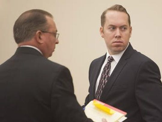 James Stuart (right), a former Deptford police officer, appears with defense attorney John Eastlack at his 2015 trial on murder and aggravated manslaughter charges.