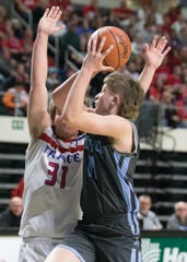 Adena's Logan Bennett shoots the ball during a 51-48 loss to Zane Trace Sunday night in a Division III district semifinal game at Ohio University's Convocation Center.