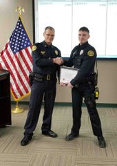 Officer Randy Cox accepting the Lifesaver Award.