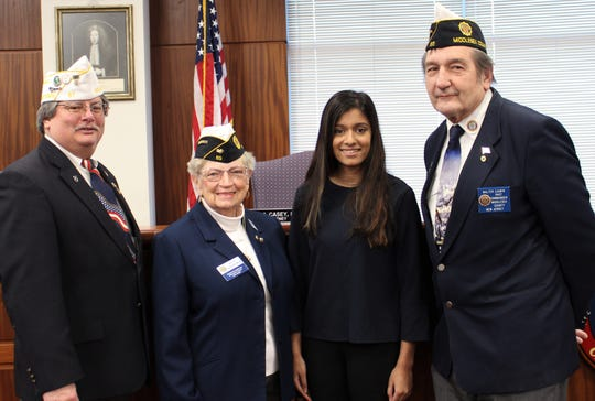 (Left to right): Daniel Dunn, District Oratorical Contest chair; Betty Baranowski, Middlesex County commander; Kiran Kumaranayakam and Walter Zjawin, Post 65 commander.