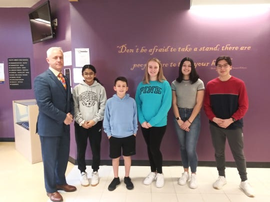 Throughout the school year, the Middle/High School teaching staff nominates students for the student of the month award. The nominations are based on character, school spirit, and academic integrity. The February winners have been announced. Pictured (left to right): Principal Dr. P.  McCabe, Middle School students: A. Moreira Burgos  (6th grade), D. Evanski (7th grade) and A. Kross (8th grade), High School students:  S. Maisonett and A. Calderon.