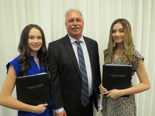 Sarah Alves of Springfield and Julia Machado of Scotch Plains join Edison Township Mayor Tom Lankey after the event.