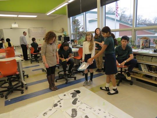 Students investigate the crime scene in the science lab.