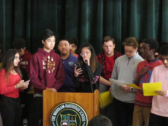 Wardlaw+Hartridge students gather around the podium to share good wishes with victims of the coronavirus in China.
