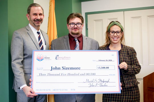 Thomas Edison State University student John Sizemore (center), who aspires to become a Drug and Alcohol counselor, accepts Recovery Scholars Program check from TESU Vice President for Public Affairs John P. Thurber (left) and Ammon Foundation Executive Director Mariel Hufnagel.