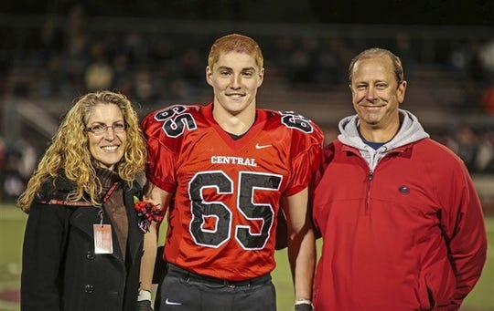 The late Tim Piazza is pictured at Hunterdon Central football game with his parents, Evelyn and Jim Piazza. A Readington resident, Piazza died in the wake of a 2017 hazing ritual at Penn State University. His mother will speak on Tuesday about hazing at Rutgers-Camden.