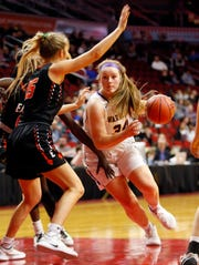 Waukee's Megan Earney drives to the basket as Sioux City East's Olivia Barnes defends during the quarterfinal round of the Iowa Girls' State Basketball Tournament at Wells Fargo Arena Monday, March 2, 2020.