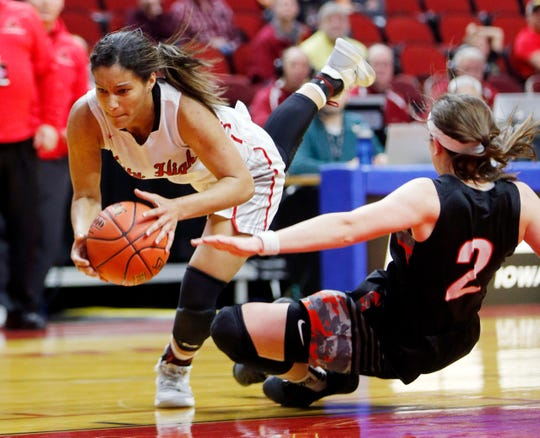 Iowa City High's Rose Nkumu collides with Cedar Rapids Prairie's Sidney McCrea during the quarterfinal round of the Iowa girls' basketball state tournament at Wells Fargo Arena.