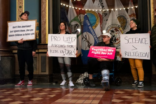 """Protestors hold signs at a """"Rally for Life"""" event on Mar. 2, 2020 at the Iowa State Capitol. Speakers opposed the 2018 Supreme Court decision of the state's constitution that gives Iowa women a fundamental right to abortion."""