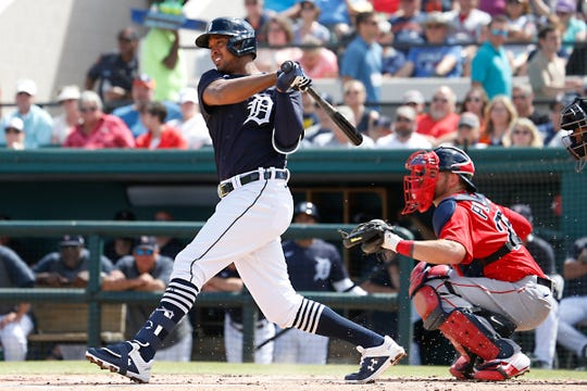 Tigers second baseman Jonathan Schoop hits a single as Red Sox catcher Kevin Plawecki looks on during the first inning of the 11-11 tie with the Boston Red Sox at Publix Field at Joker Marchant Stadium on Monday, March 2, 2020.