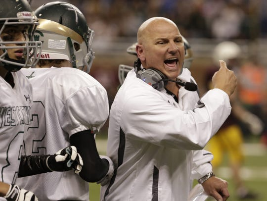 Grand Rapids West Catholic head coach Dan Rohn directs his team during fourth-quarter action at the MHSAA Division 5 State football championship, Nov. 30, 2013 at Ford Field in Detroit. Diane Weiss