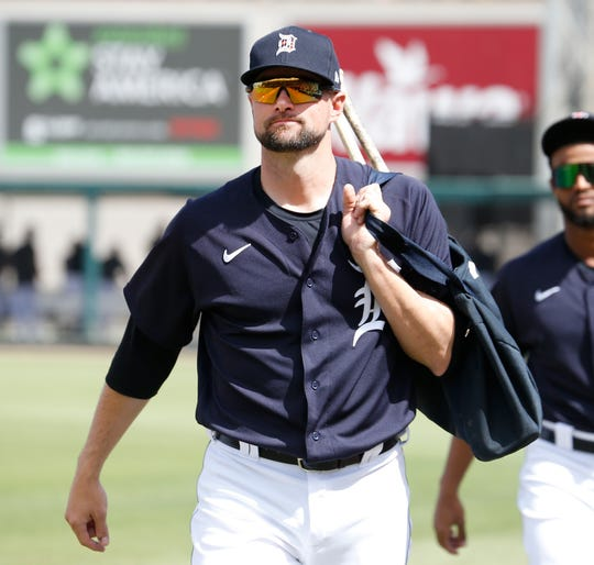Tigers infielder Jordy Mercer arrives at the bench before the 11-11 tie with the Boston Red Sox at Publix Field at Joker Marchant Stadium on Monday, March 2, 2020.