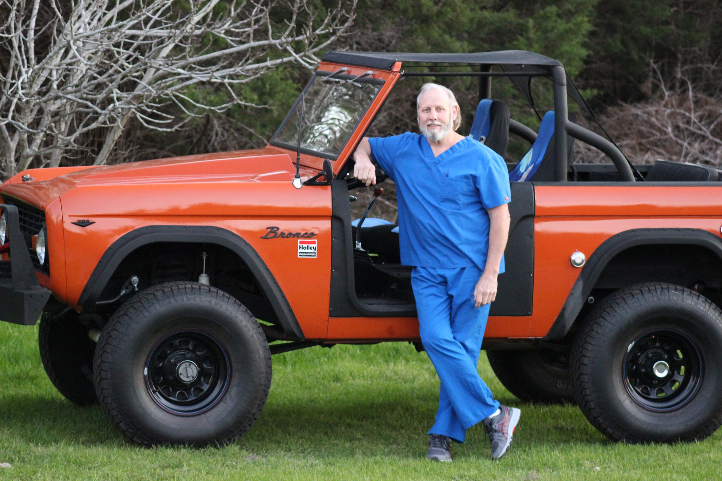 John Hall, a physician and film producer, in Bulverde, Texas, uses his Broncos like this 1967 roadster to trek the rough terrain of his deer-hunting ranch in Bandera, Texas.