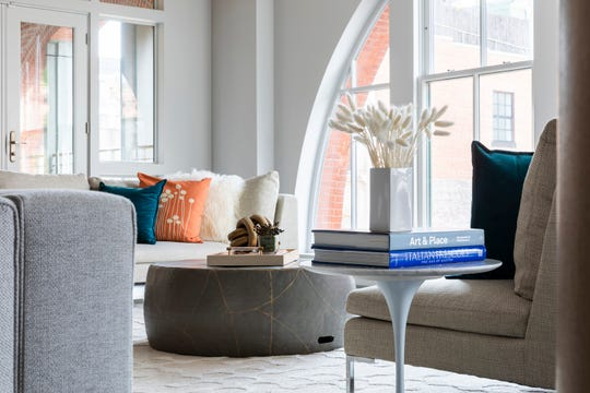 The fresh color combination of orange and turquoise makes an otherwise neutral environment welcoming and fresh.