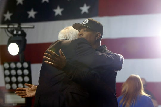 Rapper Chuck D hugs Bernie Sanders as he enters the stage to perform during a Bernie Sanders rally at the Los Angeles Convention Center on March 1, 2020, in Los Angeles, Calif.