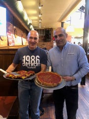 Joe Sheena, left, and his brother Mark Sheena stand in the original PizzaPapalis in Greektown.