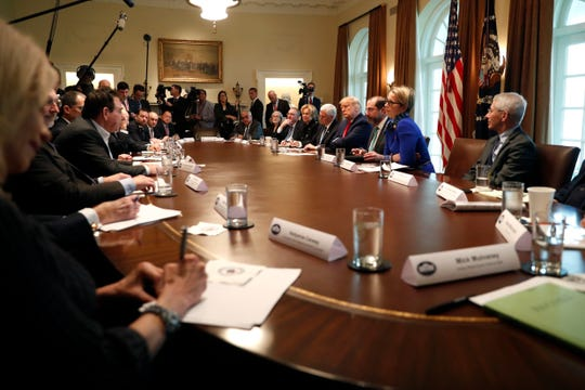 President Donald Trump and Vice President Mike Pence, accompanied by members of the coronavirus task force, meet with pharmaceutical executives in the Cabinet Room of the White House, Monday, March 2, 2020, in Washington.
