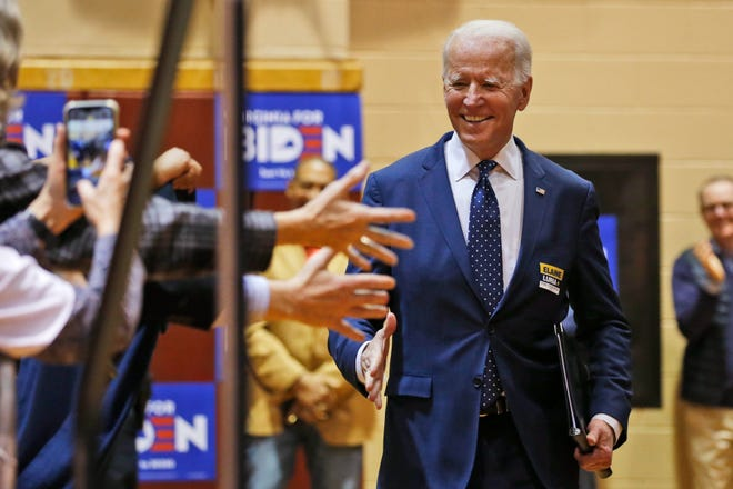 Democratic presidential candidate former Vice President Joe Biden, walks to the stage during a campaign rally Sunday, March 1, 2020, in Norfolk, Va.