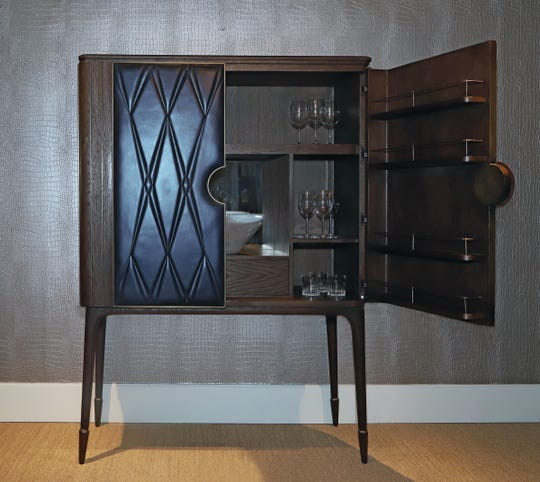 This contemporary bar unit with leather front at the Theodore Alexander showroom is featured in Michigan Design Center's Sample Sale, March 13-14.