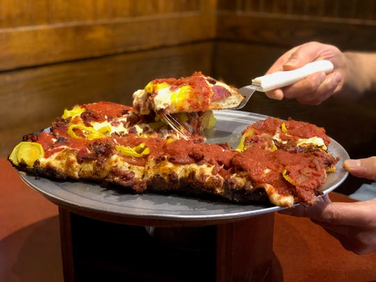 The 313 pizza at PizzaPapalis has pepperoni, bacon and yellow peppers.