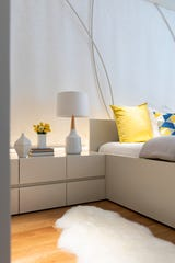 Chartreuse yellow helps make an all-cream bedroom feel open and bright.