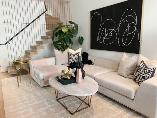 Powder pink accents add a sense of interest and glamour to this living space.