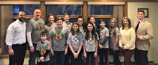 The Oak Harbor Middle School Student Council shared its activities with the Benton-Carroll-School board on Feb. 25. In front, from left, are Caden Sindeldecker, Brennan O'Neill, Myley Sandwisch, amd Kendall Gaines. In back are  Principal Laramie Spurlock, teacher Kyle O'Neill, Tyler Thompson, Braden Schultz, Allie Giezie, Madison Hand, Everett Hand, Ryleigh Brenamen-Trumbull, Betj. Sugalski and Dr. Guy Parmigian.