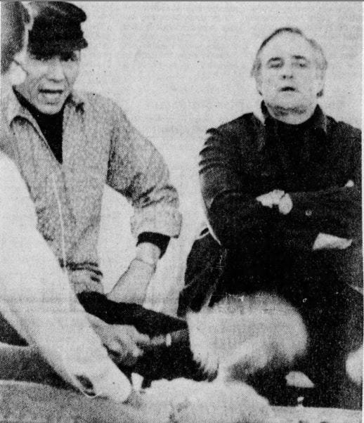 Actor Marlon Brando sits around a ceremonial drum with American Indian Movement leader Dennis Banks in Keshena in January 1975.