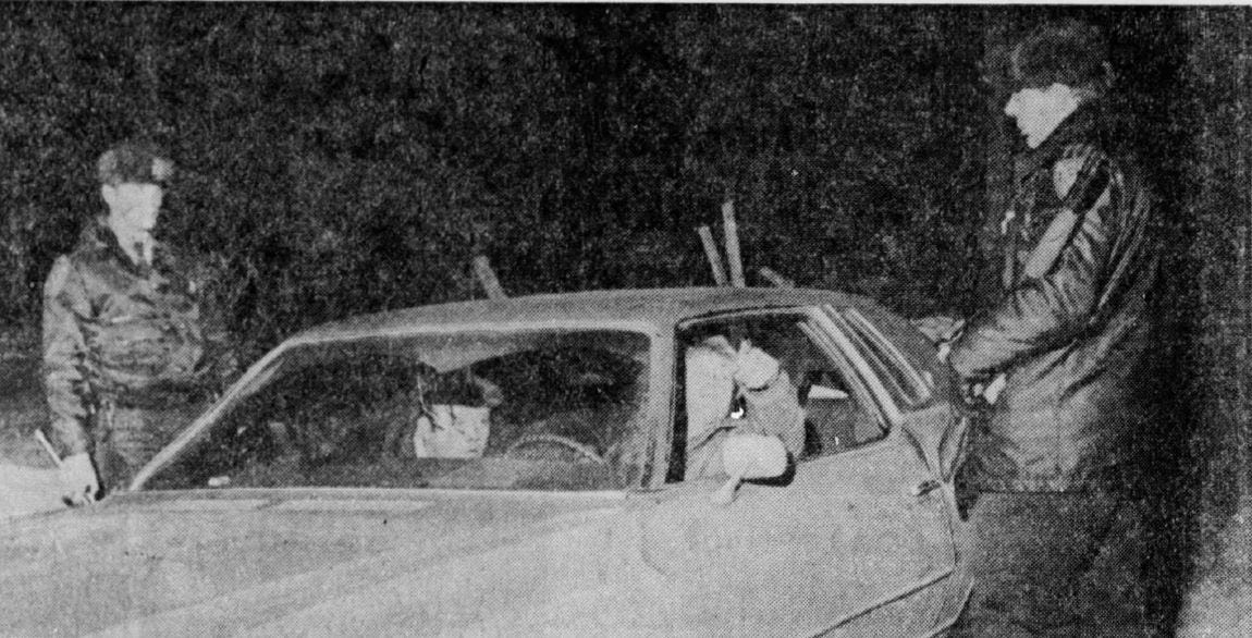 Shotgun-carrying police officers man a roadblock keeping traffic away from the Alexian Brothers Novitiate property the day after it was seized by the Menominee Warrior Society on Jan. 1, 1975.