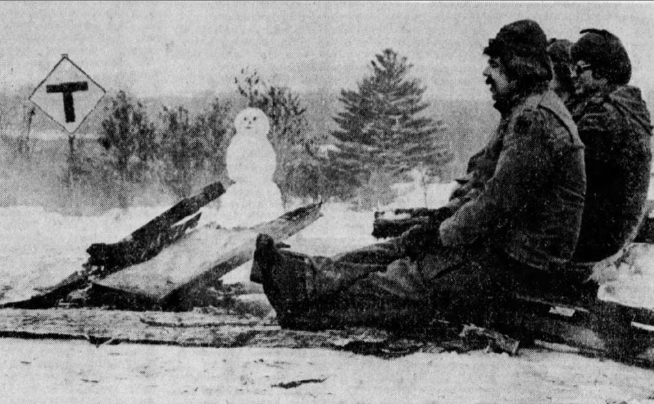 Three members of Green Bay's Army National Guard unit stay warm around a fire at a checkpoint near the Alexian Brothers Novitiate in Gresham in January 1975.