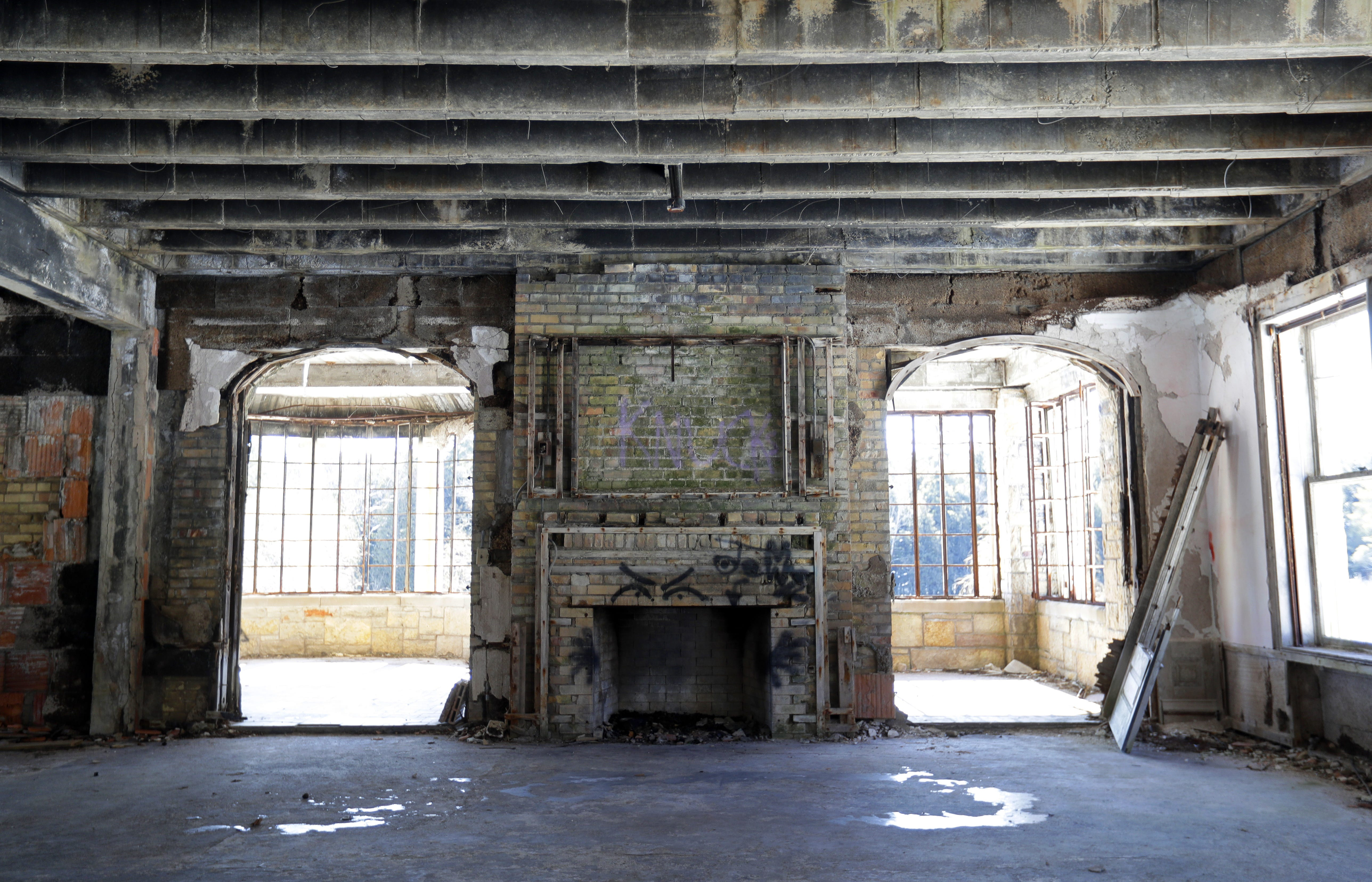 A fireplace in the dilapidated 25,000-square-foot limestone mansion on the grounds of the Alexian Brothers Novitiate in Gresham.
