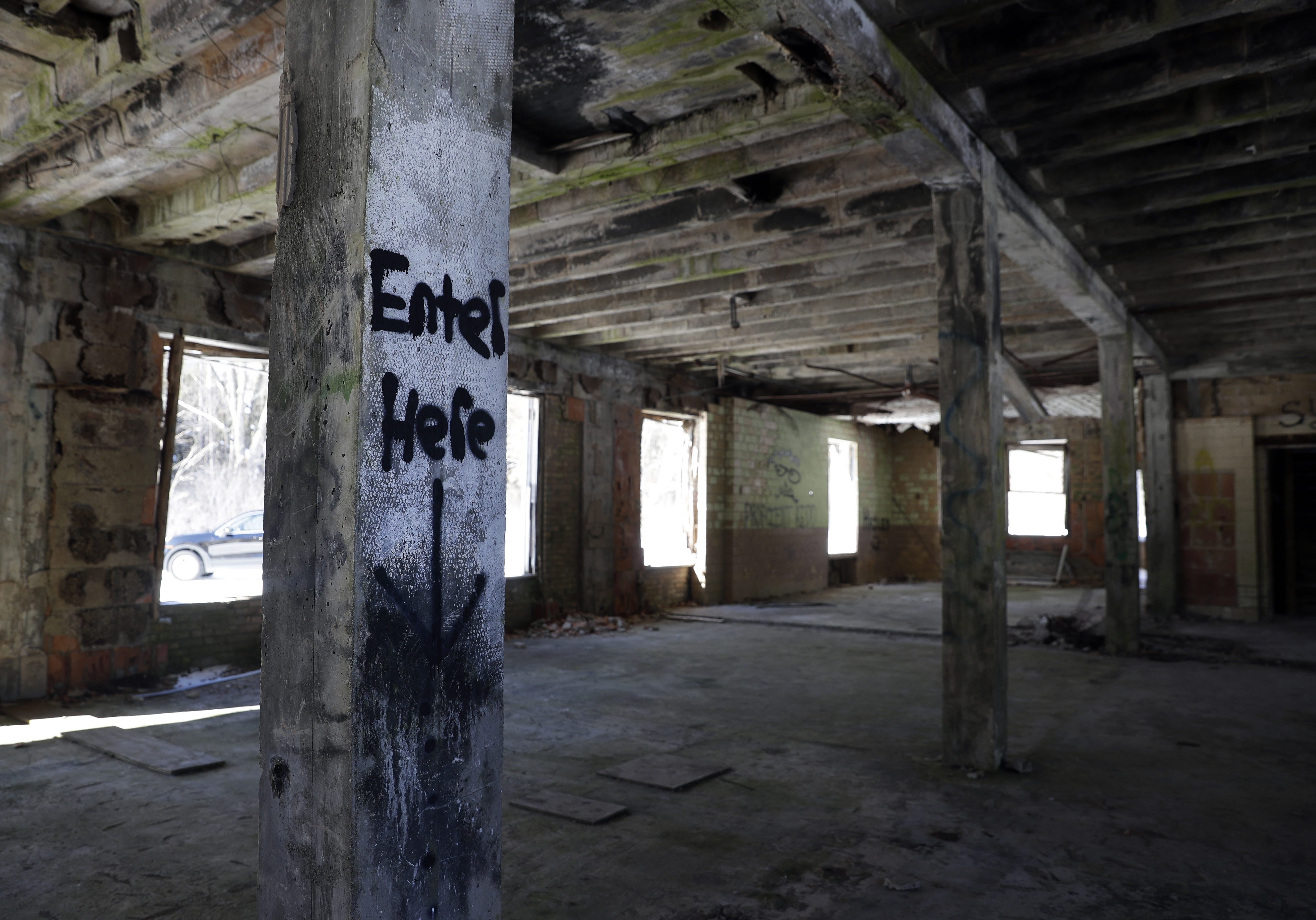 Graffiti is found throughout the dilapidated 25,000-square-foot limestone mansion on the former grounds of the Alexian Brothers Novitiate in Gresham.