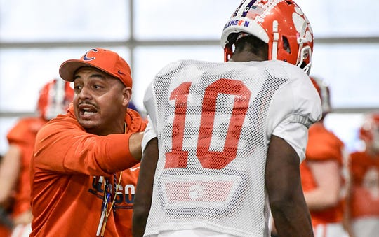 Clemson offensive coordinator Tony Elliott works with  wide receiver Joseph Ngata(10) during Spring practice at the Poe Indoor Facility in Clemson Monday, March 2, 2020.