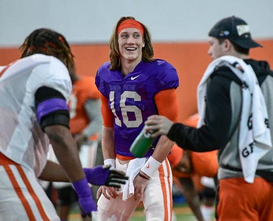 Clemson quarterback Trevor Lawrence(16) smiles before stretching during Spring practice at the Poe Indoor Facility in Clemson Monday, March 2, 2020.