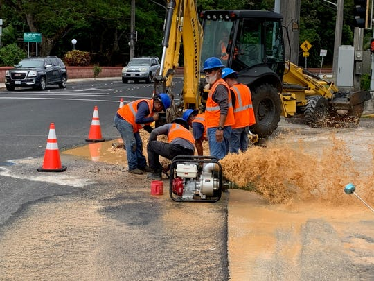 A Guam Waterworks Authority crew digs up a broken water main along West O'Brien Drive, in Hagåtña, Monday morning. Water in part of the village and in Asan will be out until 8 p.m., according to GWA.