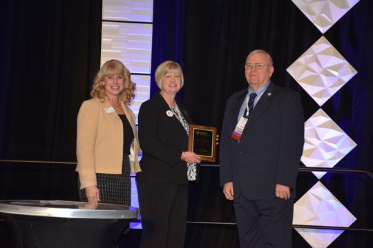 Union County Superintendent Patricia Sheffer was named the recipient of the  2020 F.L. Dupree Outstanding Superintendent Award. She is seen in the center here receiving her award.