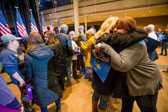 Amanda Govaert Konrath, right, hugs Joy Anderson while they wait for former South Bend Mayor Pete Buttigieg to address the crowd, Sunday, March 1, 2020, at the century Center in South Bend, Ind. Buttigieg is ending his presidential campaign.