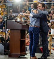 Pete Buttigieg is hugged by husband Chasten Buttigieg during a campaign rally in Raleigh, N.C., on Feb. 29.