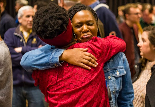 Amika Micou of South Bend hugs Rodericka Applewhaite of Washington, D.C., while they wait for Pete Buttigieg to address the crowd Sunday. He announced he was dropping out of the race.