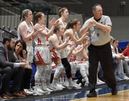 The Pine Grove Lady Panthers cheer for their teammates in the semifinals of the MHSAA State Basketball Tournament on Monday, March 2, 2020, at the Mississippi Coliseum in Jackson, Miss.
