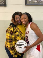 R'Daztiny Harris, right, poses with her mother, Veronica Harris.