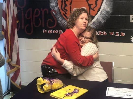 Beta Club sponsor Nicki Johnson hugs Lexington High senior Karlee Willis after Willis was awarded a full scholarship to Bethel University.