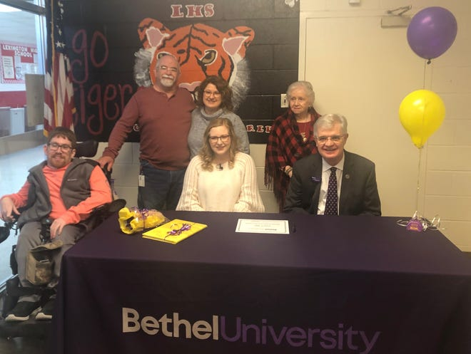 Lexington High School senior Karlee Willis is surrounded by her family, her brother Jake Willis, her parents Jeff and Carla Willis and her grandmother Barbara Willis after Bethel University president Walter Butler presented her a full scholarship.