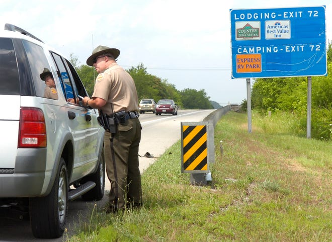 Tennessee Highway Patrol Officer Trooper Carey Hixson gives a speeding ticket on Interstate 75 in Loudon County on Wednesday. Hixson was recently named the Tennessee Highway Patrol's Trooper of the Year for the Knoxville district. In April of 2008, Hixson, a 12-year THP veteran, responded to a BOLO for an armed robbery suspect and was able to successfully capture the man, who was wanted in four armed robberies and two assaults with a deadly weapon.